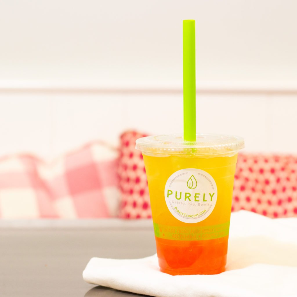 Photo of a sealed plastic cup of a fruity tea by Atlanta product photographer William Twitty.