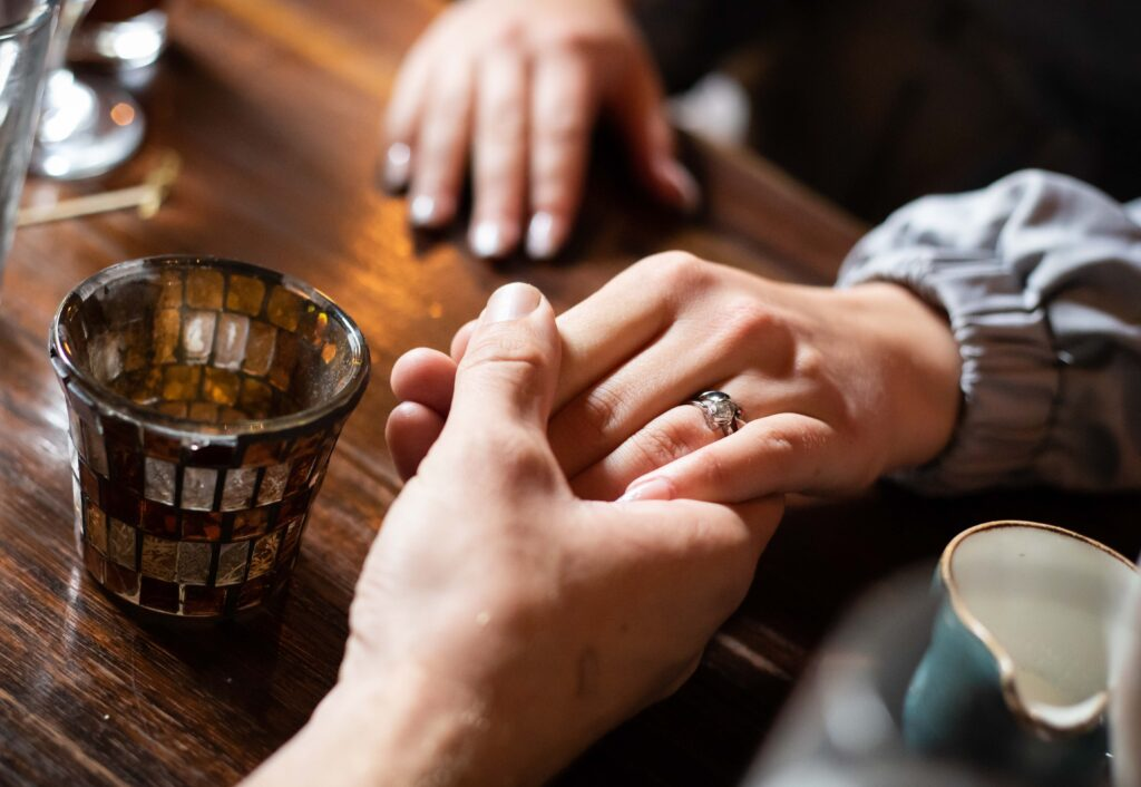 Photo of married couple's hands holding with wedding band by Atlanta product photographer William Twitty.
