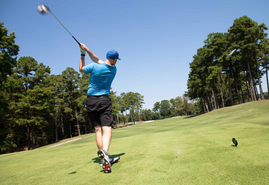 Photo of golfer swinging club by Atlanta event photographer William Twitty.