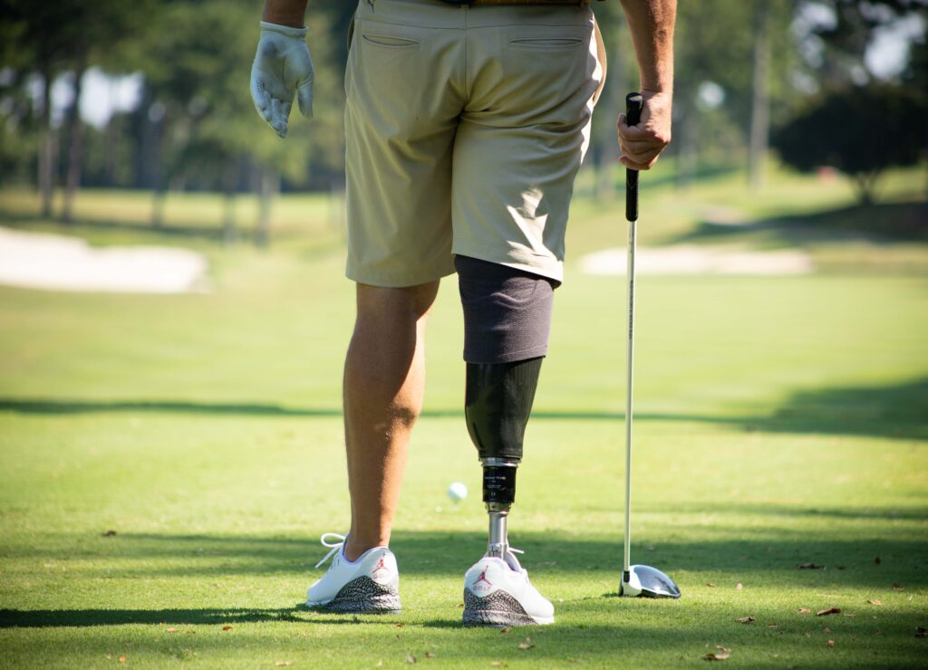 Photo of golfer standing with prosthetic leg by Atlanta product photographer William Twitty.