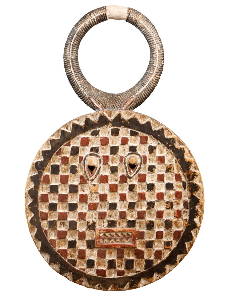 Photo of an antique-wood African shield by Atlanta product photographer William Twitty.