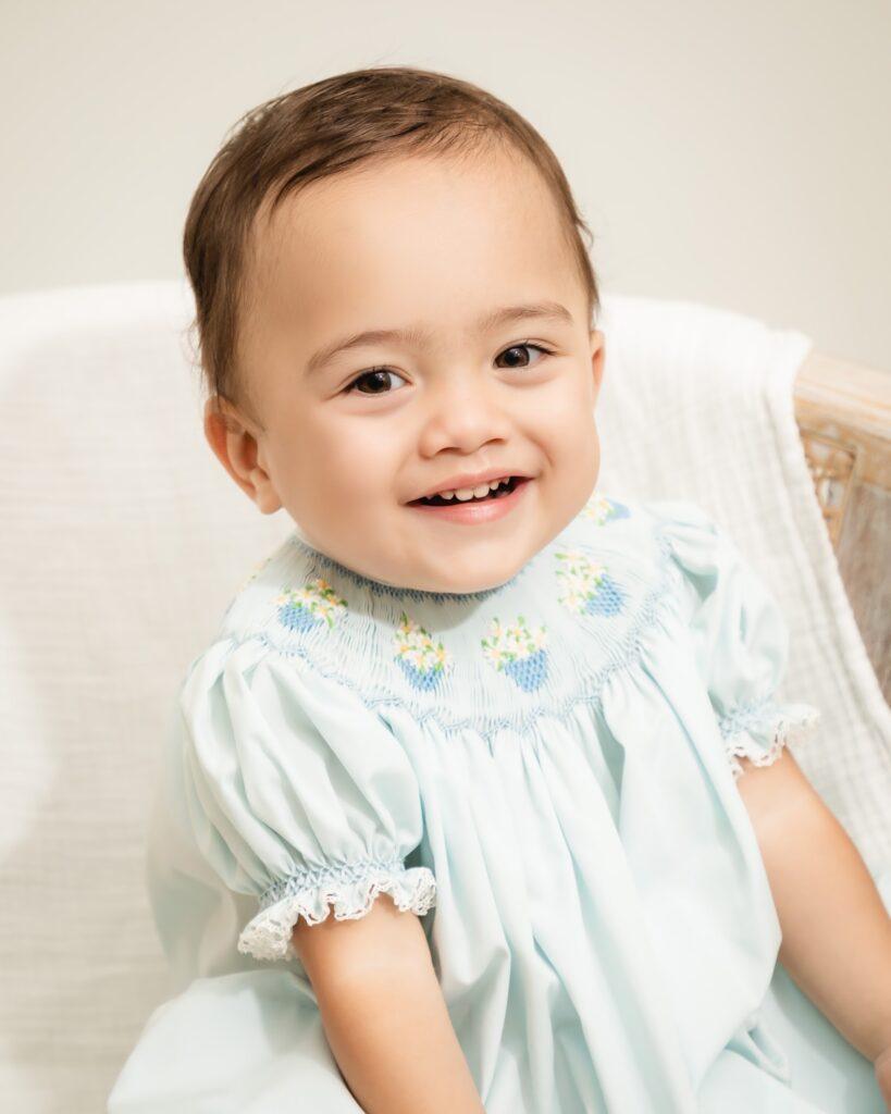 Photo of smiling baby by Atlanta portrait photographer William Twitty.