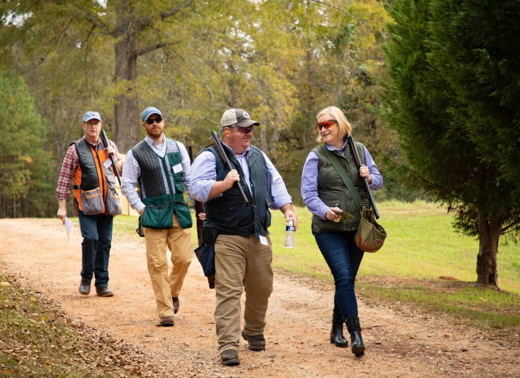 Photo of shooting team walking down the trail by Atlanta event photographer William Twitty.