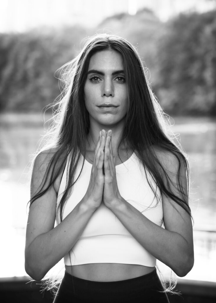 Photo of female yoga instructor meditating by Atlanta portrait photographer William Twitty.