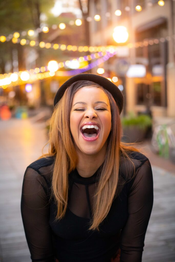 Portrait of a young woman laughing by Atlanta portrait photographer William Twitty.